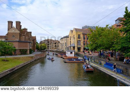Cambridge, United Kingdom - August 1, 2021: Tourist Punting On The River Cam, Viewed From Magdalene