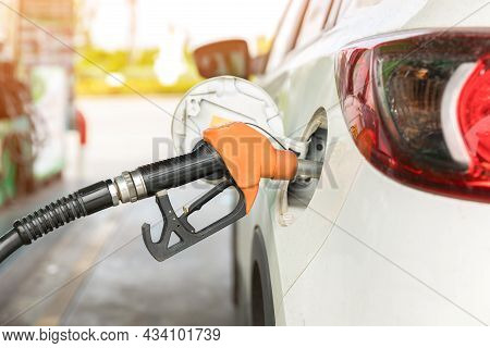 Refill And Filling Oil Gas Fuel At Station. Gas Station - Refueling. To Fill The Machine With Fuel.