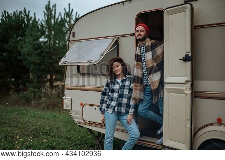 Romantic Couple Spending Time Together Near Trailer Home. Traveling Together With Motor Home.