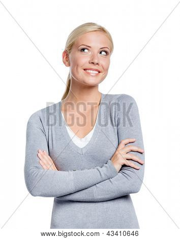 Half-length portrait of woman with arms crossed, isolated on white