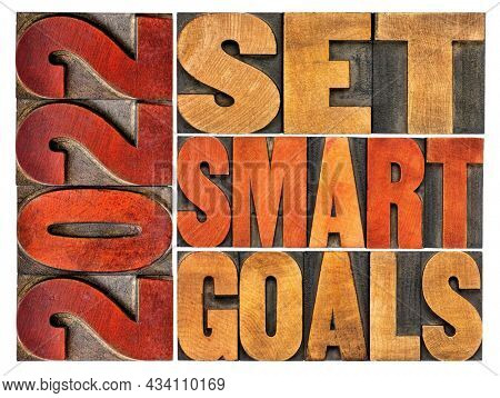 2022 set smart goals  concept - isolated word abstract in vintage letterpress wood type, goal setting for New Year