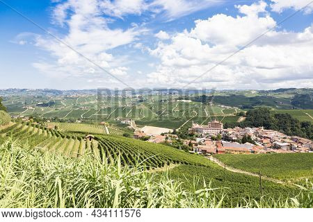 Panoramic Countryside In Piedmont Region, Italy. Scenic Vineyard Hill With The Famous Barolo Castle