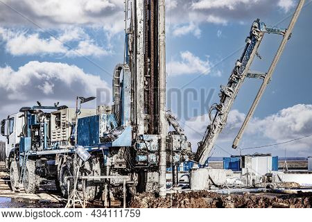 The Drilling Rig Close-up Is Drilling A Well Against The Background Of The Cloudy Sky. Deep Hole Dri