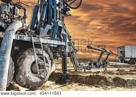 Drilling Rig Works On Site At Sunset. Close-up. Deep Hole Drilling. Geological Exploration Work. Min