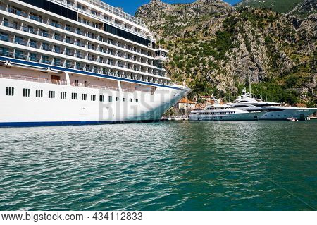 Kotor, Montenegro - 30 June, 2019: View Of The Large Cruise Ship In The Bay Of Kotor, Montenegro