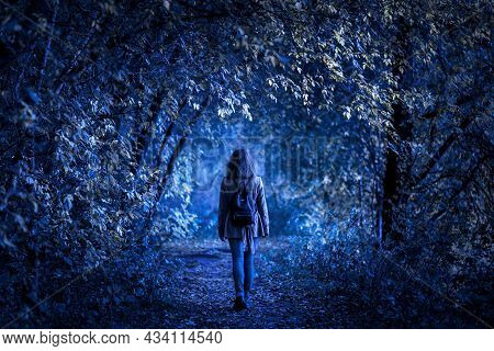 Dark Forest On Halloween, Young Woman In Fantasy Spooky Woods At Night. Girl Walking Alone On Path I
