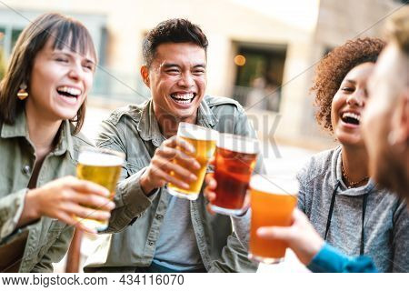 Group Of Happy Multiethnic Friends Drinking And Toasting Beer At Brewery Bar Restaurant - Beverage C