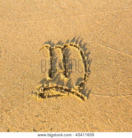 Zodiac sign Virgo, drawn on the facture beach sand. (zodiac signs series)