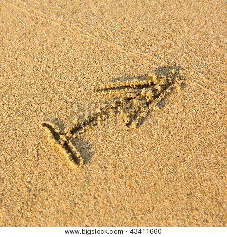 Zodiac sign Sagittarius, drawn on the facture beach sand. (zodiac signs series)