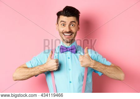Happy Young Man Showing Thumbs Up And Smiling, Saying Yes, Agree With Something Cool, Recommending E
