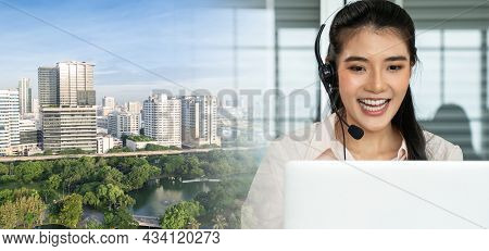 Businesswoman Wearing Headset Working Actively In Office . Call Center, Telemarketing, Customer Supp
