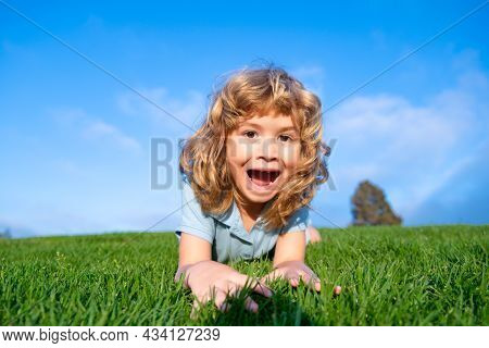 Portrait Of A Excited Funny Boy In The Park. Funny Little Boy Playing In Garden Backyard Laughing An