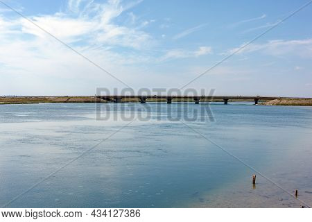 Henichesk Strait. View Of The Strait And The Bridge Connecting The Two Banks.