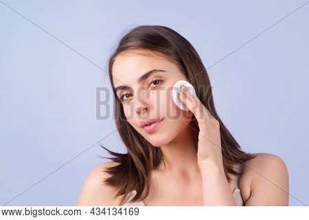 Closeup Face Of Beautiful Young Woman With Cotton Pads, Sponge, Cotton Ball. Skin Care And Beauty Co