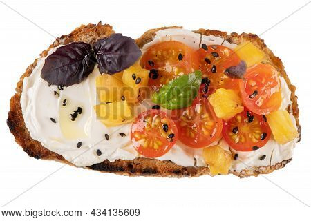 Italian Bruschetta With Roasted Tomatoes, Mozzarella Cheese, Pineapple Slices And Herbs Isolated On