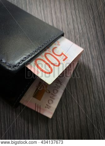 500 Swedish Krona Bill In Black Leather Wallet. Close Up Photo Of Wallet With Money Isolated On Dark