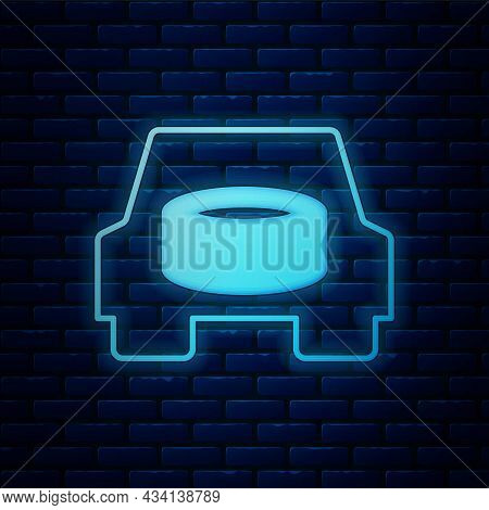 Glowing Neon Spare Wheel In The Car Icon Isolated On Brick Wall Background. Process Of Replacing The
