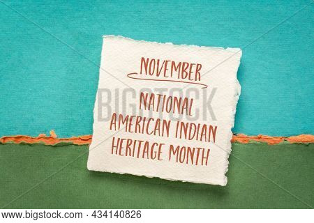 November - National American Indian Heritage Month, handwriting on a handmade paper against abstract paper landscape, reminder of  historical and cultural event