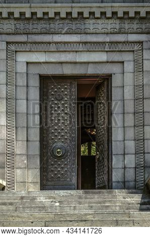 Huge Front Double-leaf, Forged Black Door With A Beautiful Pattern And Golden Door Handles, Framed B