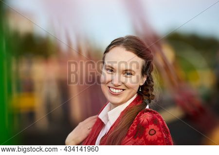 Portrait Of Cheerful Woman 34 Years Old Outdoors.