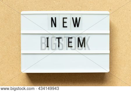 Lightbox With Word New Item On Wood Background
