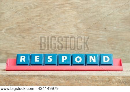 Tile Alphabet Letter With Word Respond In Red Color Rack On Wood Background