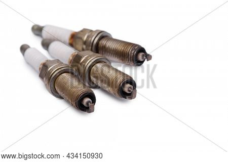Old used spark plug isolated on white background