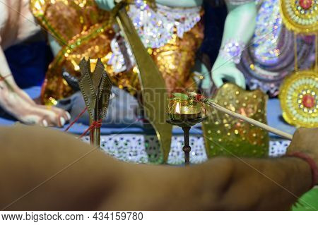Holy Flame Purifying Belpata Tied On Stick For Pran Protistha Of Goddess Durga, Puja By Worshipping