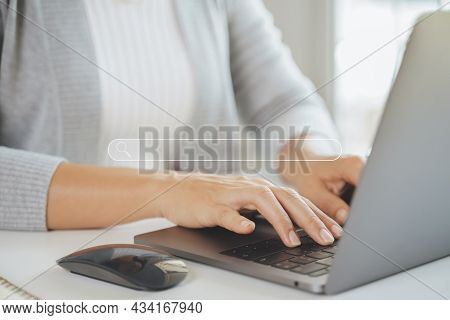 Woman Using A Laptop Computer To Searching For Information With The Search Bar, Web Browser, Data Se