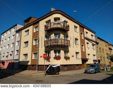 Ceske Budejovice, Czech Republic - September 5, 2021: A Beige Corner Apartment Building With Balcony