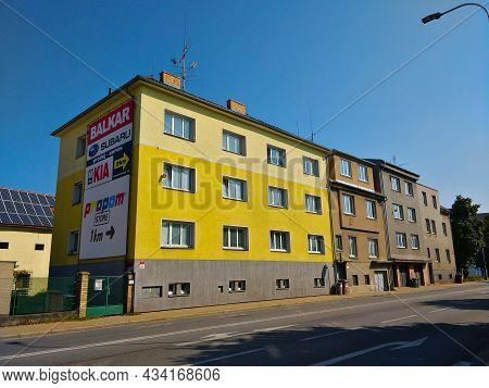 Ceske Budejovice, Czech Republic - September 5, 2021: A Yellow Three Story Building With One Side Co
