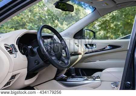 Infinity Brand Car Interior. Car Interior With Beige Leather Upholstery. Moscow, Russia - 08.22.2021