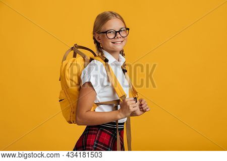 Smiling Glad Clever European Teenager Girl Student In Glasses With Pigtails And Backpack Look At Cam