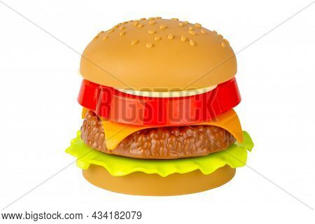 Plastic Burger On A White Background. Not Real Food. Toy Cheeseburger. Isolate On A White Background