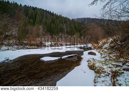 Winter River In The Mountains In A Cloudy Rogoda. Winter Landscape