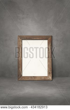 Wooden Picture Frame Leaning On A Dark Concrete Wall. Blank Mockup Template