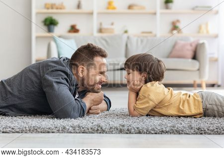 Side View Portrait Of Handsome Father And His Cute Little Son Looking At Each Other And Smiling, Lyi