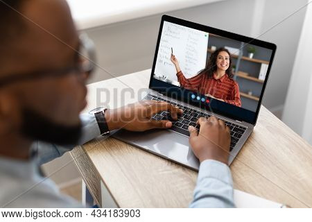 Cropped Afro American Male Student Watch Online Lecture With Virtual Class And Multiracial Teacher O
