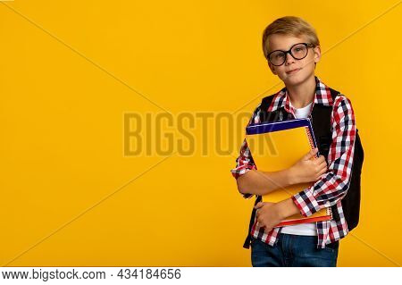 Calm Clever Caucasian Teenage Boy Pupil In Glasses With Books And Notebooks Ready To Study In School