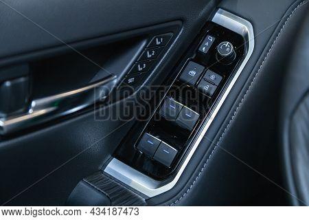 Novosibirsk, Russia - September    24 , 2021: Toyota Land Cruiser 300, Car Door Interior Armrest Wit