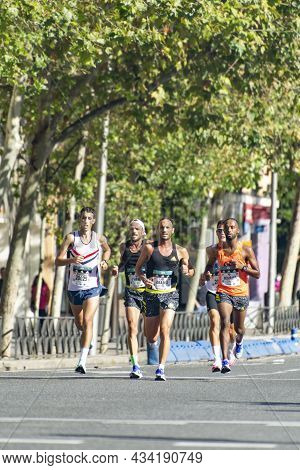 Madrid, Spain - September 26, 2021.  Group Of Professional Athletes Walking The Streets Of Madrid Do