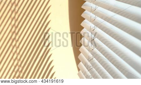 Window With Open Modern Horizontal Blinds Indoors. The Sunlight Shines Through The Venetian Blinds,