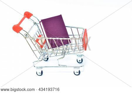 Blue Cover Book Carrying On Shoppi\ng Cart In White Background