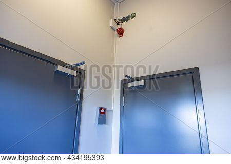 Close Up View Of Two  Extra Heavy Doors With  Heavy Aluminium Door Closer. Technology Background. Sw
