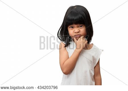 Portrait Of Asian Angry And Sad Little Girl On White Isolated Background, The Emotion Of A Child Whe