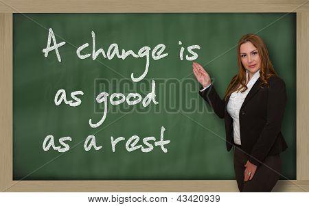 Teacher Showing A Change Is As Good As A Rest On Blackboard