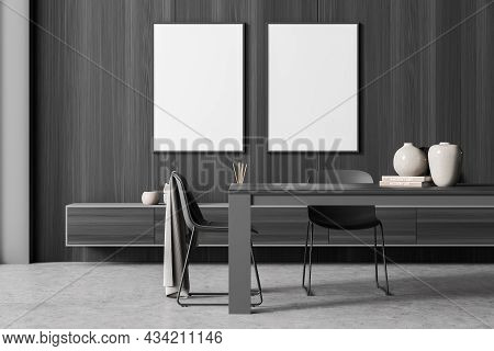 Dark Grey Living Room Interior Design With Two Empty Canvases On The Wood Wall And Three Chairs Near