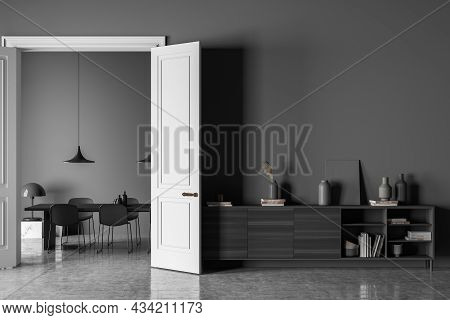 Dark Living Room Interior With Empty Grey Wall, Chairs, Dining Table, Doors, Sideboard And Concrete