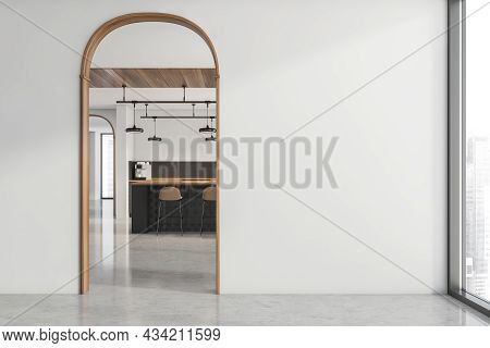 White Spacious Apartment Interior With Archways, An Empty Wall And A Stylish Kitchen With A Breakfas
