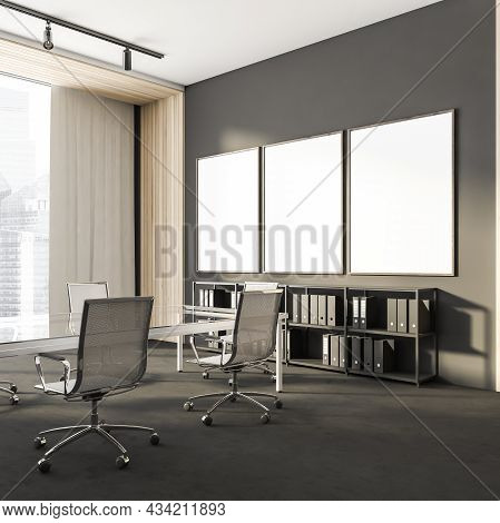 Corner View On Dark Office Room Interior With Three Empty White Posters, Panoramic Window, Large Tab